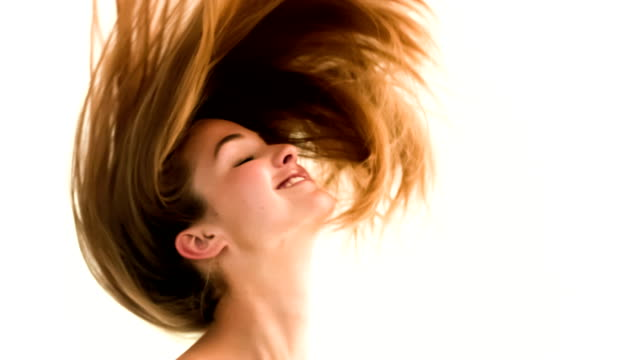 Woman shaking her hair in slow motion