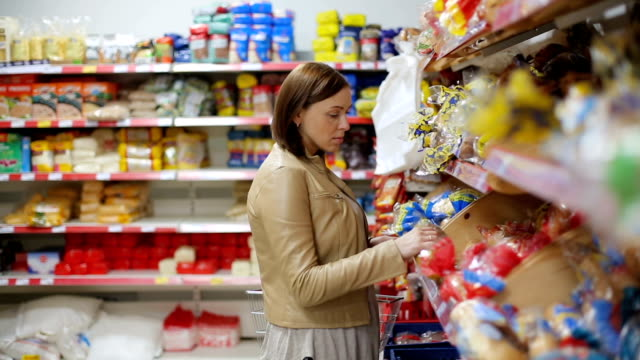 Woman shopping bread in the store Young woman shopping food in the store bread stock videos & royalty-free footage