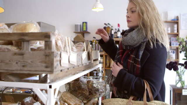 Woman Shopping For Organic Bread In Delicatessen video