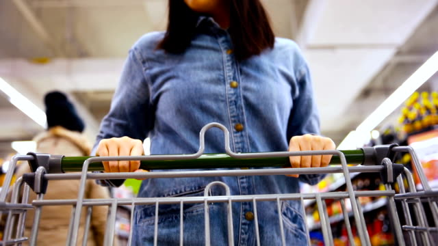 Woman shopping in a supermarket Woman shopping in a supermarket consumerism stock videos & royalty-free footage