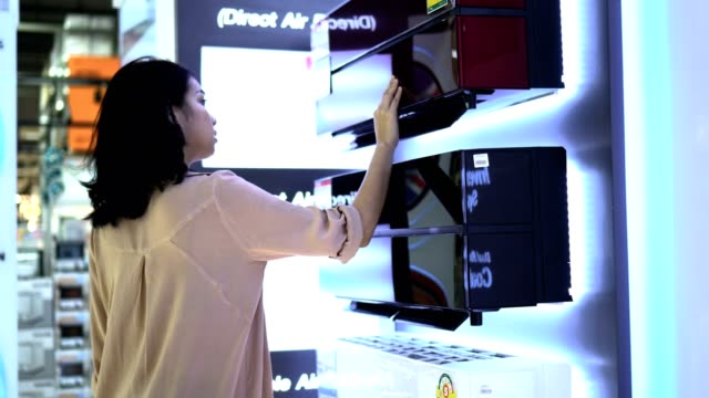 Woman Shopping in Electronics Store Asia Woman Shopping in Electronics Store electrical equipment stock videos & royalty-free footage