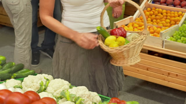 HD DOLLY: Woman Shopping In Greengrocer'S Shop video