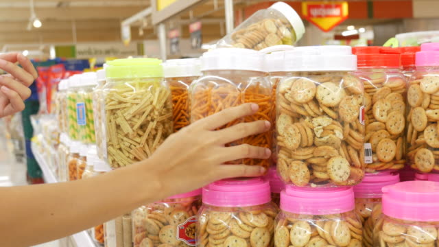Woman shopping in supermarket Woman shopping in supermarket,Stabilized Shot snack stock videos & royalty-free footage