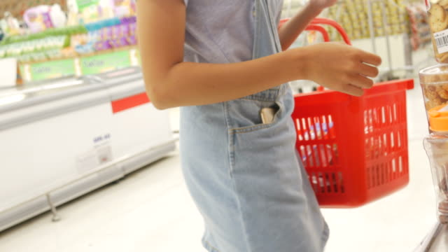 Woman shopping in supermarket Woman shopping in supermarket,Stabilized Shot snack aisle stock videos & royalty-free footage