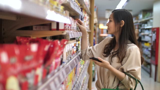 Woman shopping in Supermarket Woman shopping in Supermarket market retail space stock videos & royalty-free footage