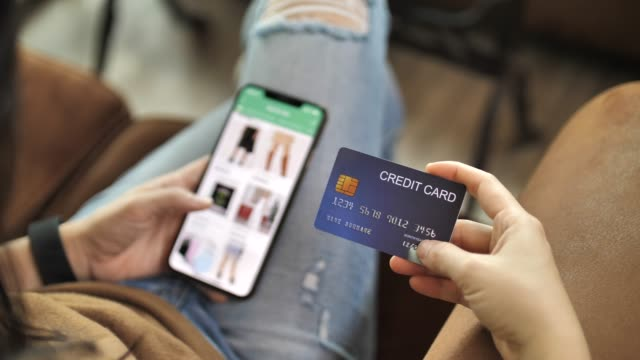 Woman Shopping online shopping on Smart phone with Credit card