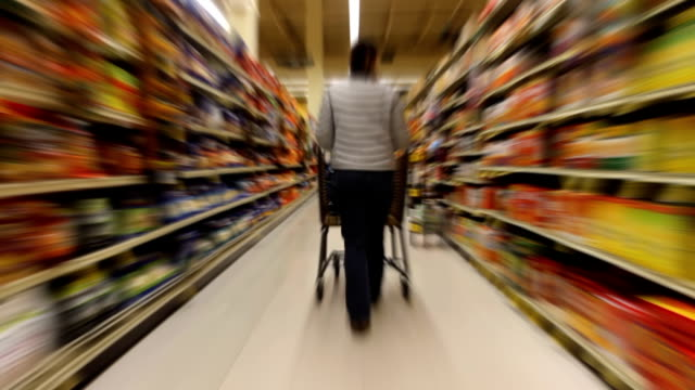 Woman Shopping Time Lapse Time lapse of a woman shopping with kids in a supermarket woman pushing cart stock videos & royalty-free footage