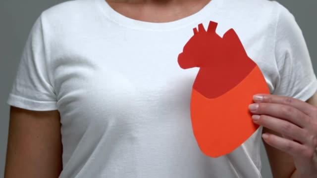 vídeos de stock e filmes b-roll de woman showing heart sign at camera, health care, blood problems prevention - coração fraco