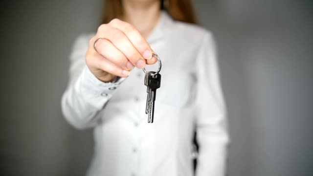 Woman Showing House Keys 4