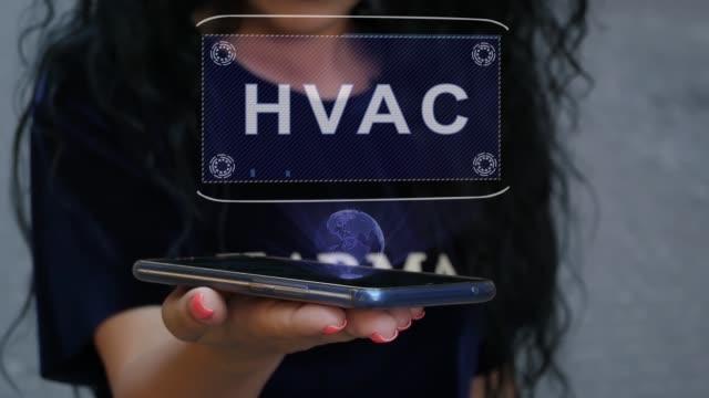 kvinna som visar hud hologram hvac - kvinna ventilationssystem bildbanksvideor och videomaterial från bakom kulisserna