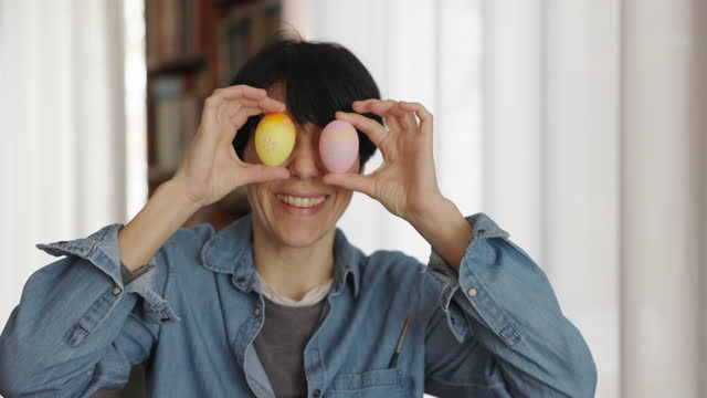 Woman showing painted Easter eggs video