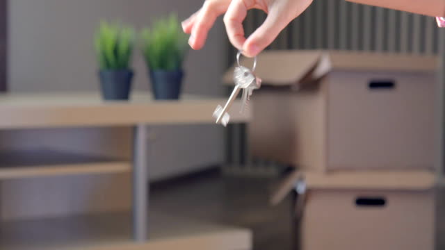 Woman Showing The House Keys, real time video