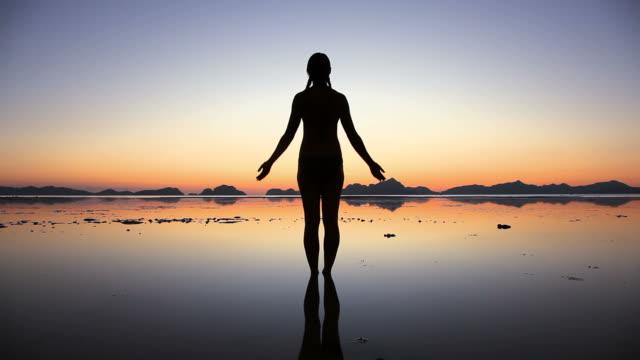 Woman silhouette symbolizing peace, harmony and balance video