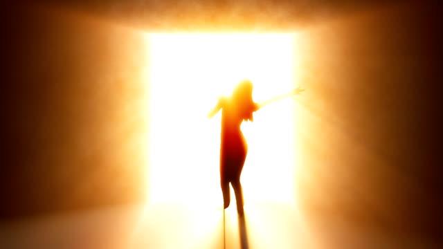 Woman singing. Amber. video