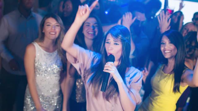Woman singing at the nightclub video