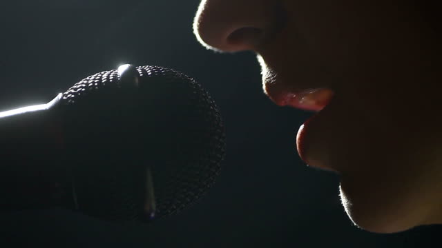 Woman singing to microphone video