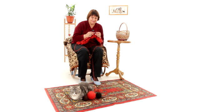 Woman sits and knits gift video