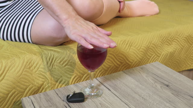 Woman sitting and refusing glass of wine.Don`t drink and drive concept - vídeo