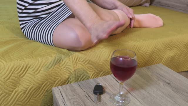 Woman sitting near car keys,alcohol and refusing glass of wine - vídeo