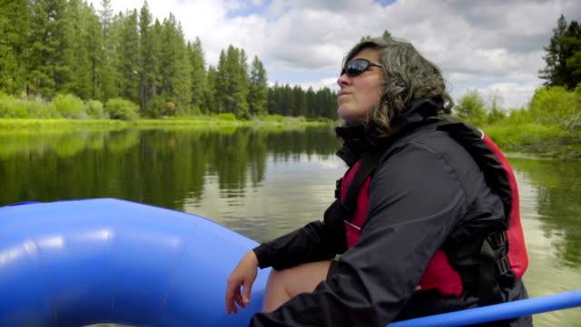 Woman sitting on raft video