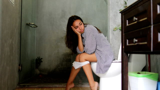 Woman Sitting On Toilet In Bathroom Young Girl Beautiful Smiling video