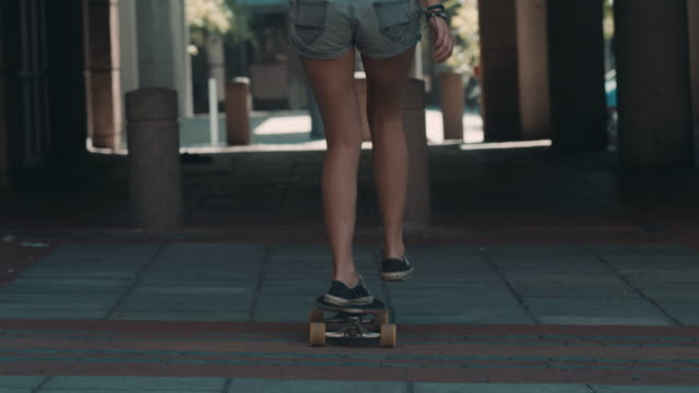 Woman skating in urban setting video