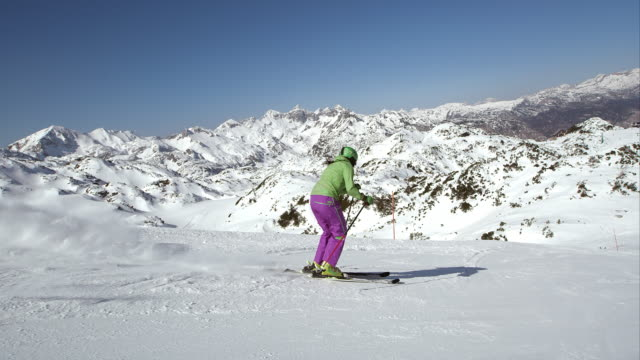 SLO MO TS Woman skier skiing down the ski track