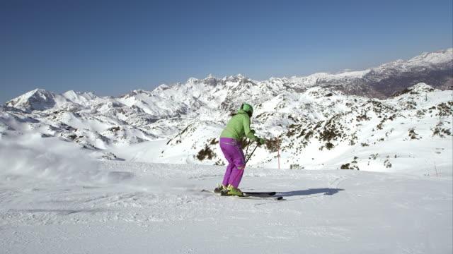 SLO MO TS Woman skier skiing down the ski track video