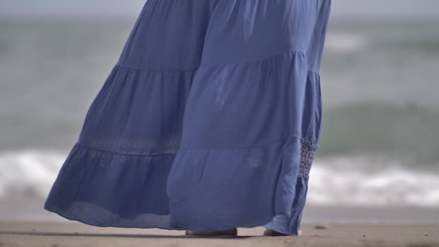 Woman skirt develops in the wind on the coast video