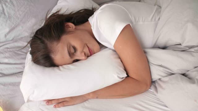 Woman sleeping in comfortable bed