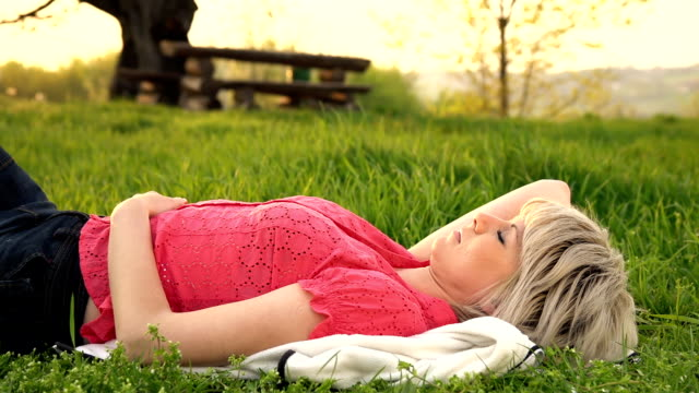 HD DOLLY: Woman Sleeping In Grass video