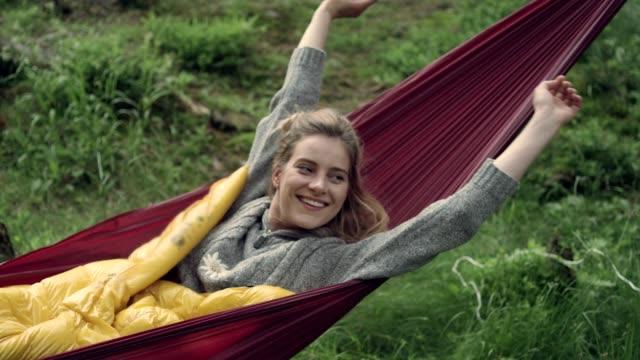 woman sleeping in hammock. outdoor relaxation - amaca video stock e b–roll