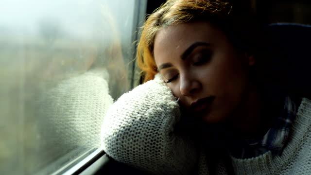 Woman sleeping in train video