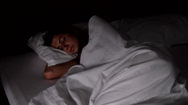 Woman Sleeps In Bed In The Dark Quickly Dawning, The Light Interferes With Sleep video