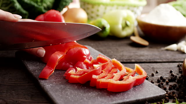 Woman slicing pepper video