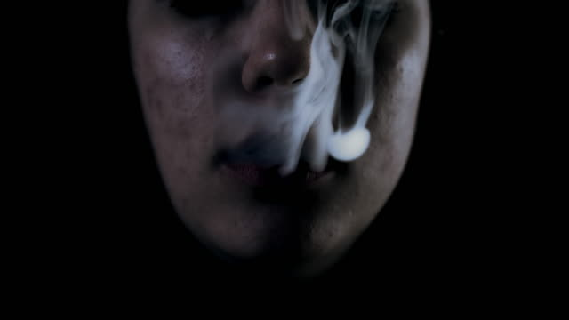 SLO MO Woman slowly blowing a smoke video