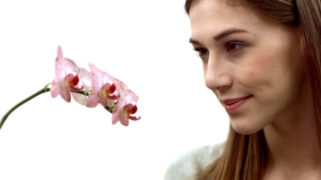 HD: Woman Smelling An Orchid