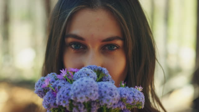 Woman smelling at flowers