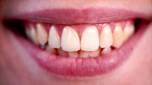 woman smiling and showing her teeth - denti video stock e b–roll