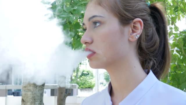 woman smoke e-cigarette video