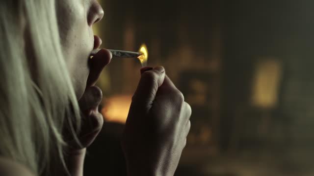 Woman smoking marijuana joint Woman smoking pot headshot marijuana stock videos & royalty-free footage