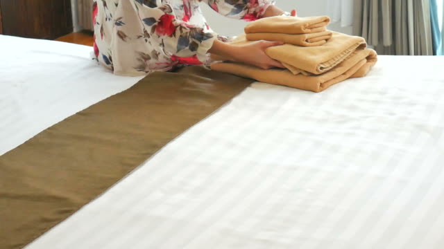Woman smoothing a fresh towel video