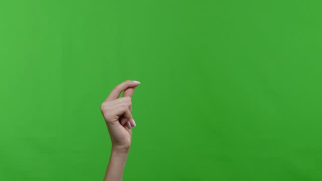 Woman snapping her fingers over chroma key background Woman snapping her fingers over green chroma key background. 4k snapping stock videos & royalty-free footage