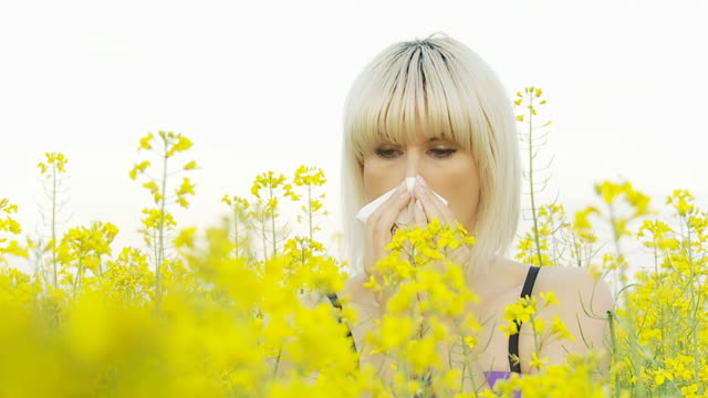 HD SLOW MOTION: Woman Sneezing From Pollen Allergy video