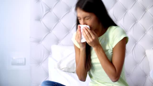 Woman sneezing. video