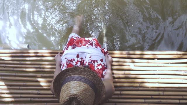 woman splashing water top view. video