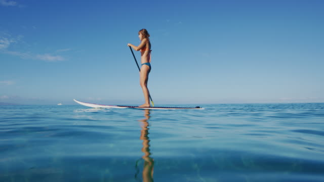 Woman Stand Up Paddle Boarding video