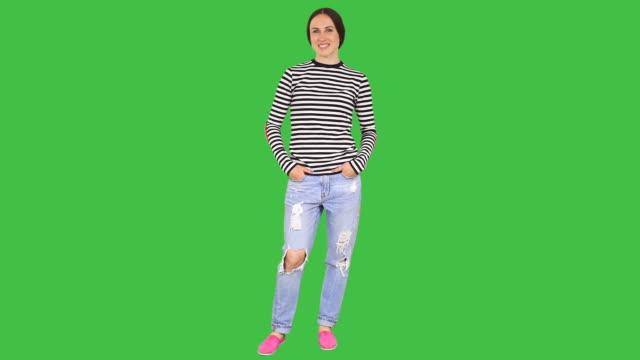 woman standing in confident pose - helkroppsbild bildbanksvideor och videomaterial från bakom kulisserna