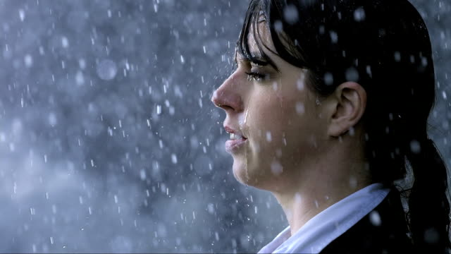 Woman Standing In The Heavy Rain HD1080p: Slow Motion shot of a businesswoman standing in the heavy rain without umbrella. drenched stock videos & royalty-free footage