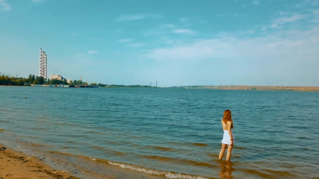 Woman standing in the water admiring the view video